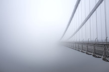 Clifton Suspension Bridge In The Fog From The Side