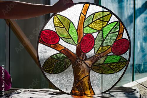 Fotografía  Stained glass lead light artwork held by artist