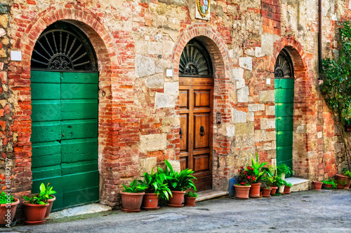 Charming floral decorated old streets of medieval towns of Italy. © Freesurf