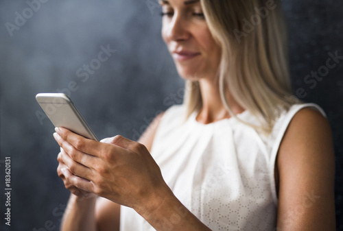 Close-up of woman holding cell phone