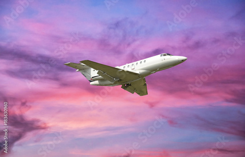 Fotografie, Obraz  Airplane flying over clouds at sunset
