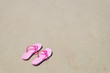 Pink sandal on Tien Beach at Koh Larn Island in Thailand.