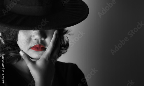 Printed kitchen splashbacks Beautiful young woman wearing black dress, black hat and red lips in the dark concept, Concept : dark, halloween, mysterious, depressed