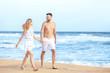 Happy couple on sea beach at resort