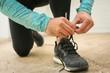 Sportsman tying shoelaces.