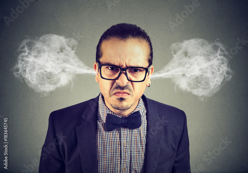 Fotografering  Angry business man, blowing steam coming out of ears, about to have nervous breakdown isolated on gray background