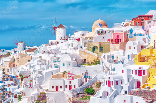 Stunning, amazing and beautiful classic white and caramel  color Greek architecture with unbelievable wind mills on Santorini volcano Cyclades Caldera island in warm waters of Aegean sea in Greece Canvas Print
