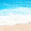 Soft wave of blue ocean on sandy beach Background with place for text. Tropical summer vacation