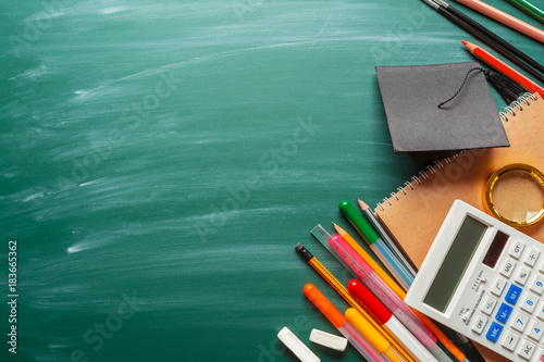 Fotografie, Obraz  School supplies on chalkboard background