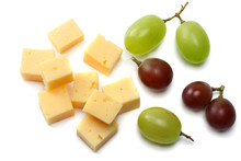 Piece Of Cheese With Grapes Isolated On White Background