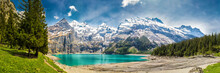Amazing Tourquise Oeschinnensee With Waterfalls In Swiss Alps