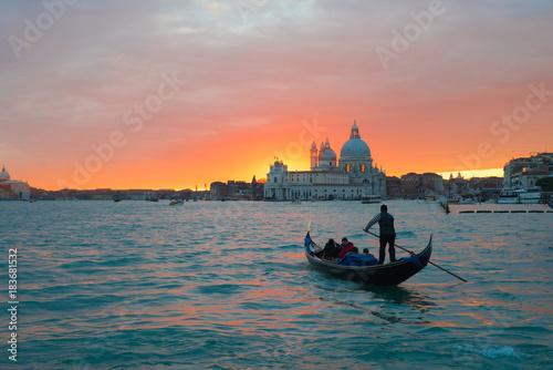 Spoed Foto op Canvas Gondolas Beautiful sunset in Venice over canal. Gondola in sunset