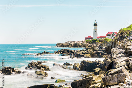 Cliff rocks side view shore with Portland Head Lighthouse in Fort Williams park Poster