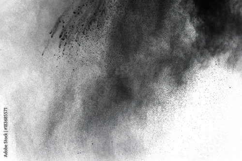 Black powder explosion against white background Canvas Print