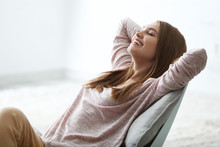 Happy Young Woman Relaxing At ...