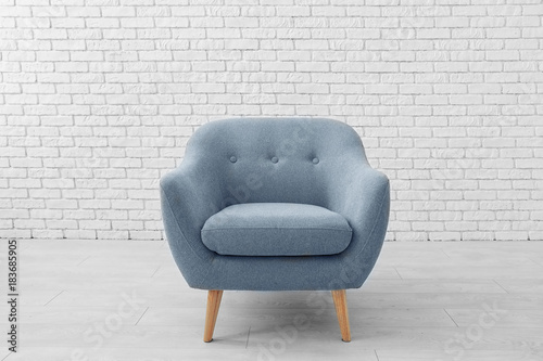 Tela Comfortable armchair near brick wall
