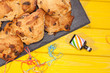 Rock cakes party food in close up with party popper streamer. Simple fun celebration snack.
