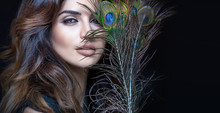 Sensual Woman With Peacock Feather.
