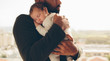 Leinwandbild Motiv Newborn baby boy in his father's arms