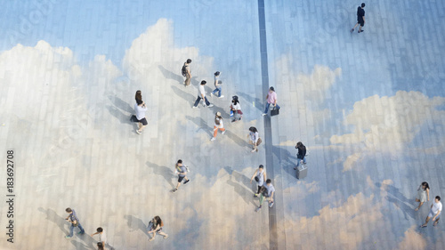 Valokuva  top aerial view people walk on the pedestrian city street walkway on pavement concrete reflect cloud and blue sky