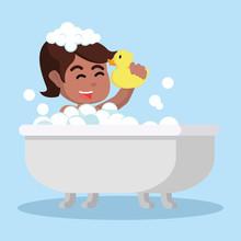 Girl In Bathtub Holding A Toy ...