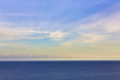Blue sea on sky background. Beautiful blue sea against the blue sky. Mediterranean Sea. Sea and sunset.