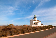 OLD POINT LOMA LIGHTHOUSE AND MUSEUM AT CABRILLO NATIONAL MONUMENT UNDER BLUE CIRRUS CLOUDS AT POINT LOMA SAN DIEGO CALIFORNIA UNITED STATES