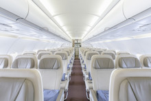 Interior Of Empty Ready To Fly Airliner Cabin With Rows Of Seats.