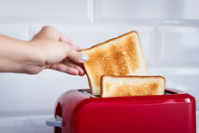 Red Toaster With Toasted Bread...