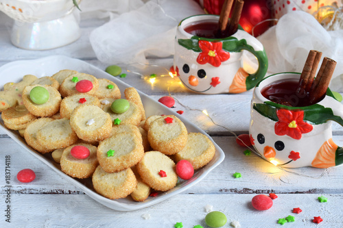 Stickers pour portes Pique-nique Christmas and new year holiday celebration concept background. Mug of mulled wine with spices, homemade nut cookie, shortbread, xmas tree decoration on wooden table