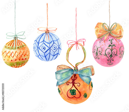 set of christmas balls hanging with bows and rope orange red blue