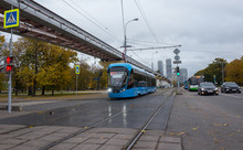 Blue Electric Tram On The Back...