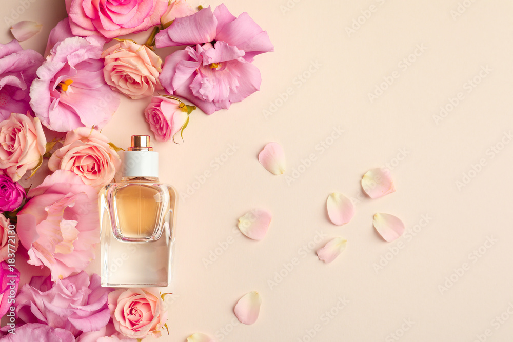Fototapety, obrazy: Bottle of perfume with flowers on light background