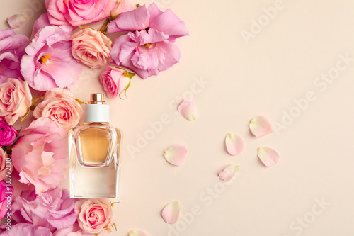 Obraz Bottle of perfume with flowers on light background - fototapety do salonu