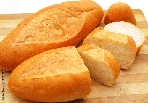 Fotografie, Obraz  The cut bread on a chopping board.