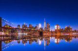 New York City Panoramic landscape view of Manhattan with famous Brooklyn Bridge at dusk .