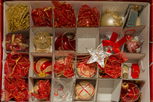 Poster Confiserie close up red open box of Christmas decorations.jpg
