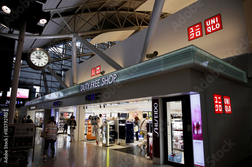 people shop at a uniqlo by fast retailing store at kansai international airport in osaka