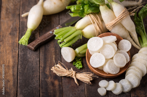 White organic radishes on the wooden table