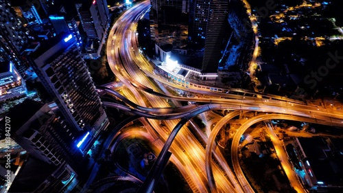 Acrylic Prints Night highway Aerial photography of urban city highway with traffic's light trail at night.