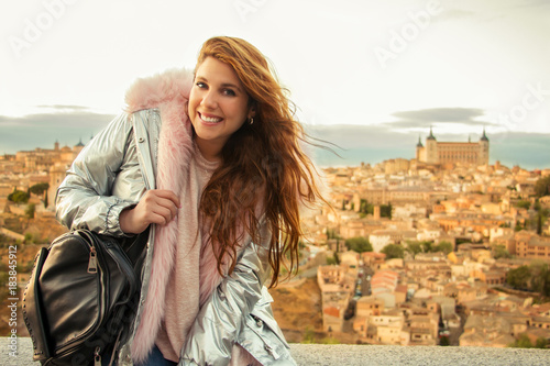 Portrait of a smiling young tourist in Toledo (Spain) with the Alcazar in the background Wallpaper Mural