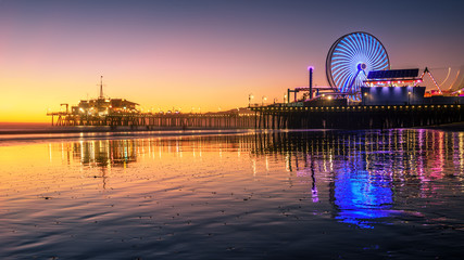 Fototapeta Santa Monica beach and pier in California USA at sunset