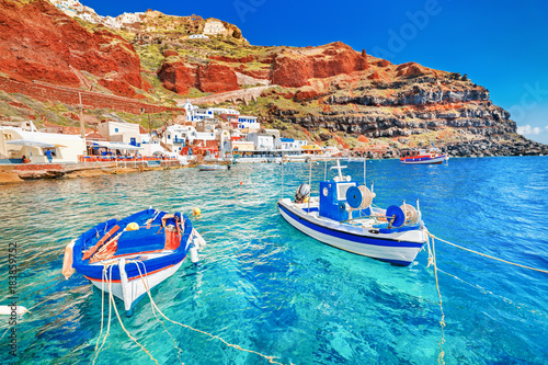 Montage in der Fensternische Santorini Greece. Breathtaking beautiful landscape of two fishing boats anchored to quay in fascinating blue water at the amazing old port panorama in Oia Ia village on Santorini Greek island in Aegean sea.