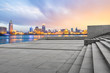 canvas print picture - Empty square and modern cityscape at sunset in Shanghai,China