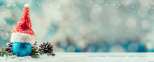 Christmas Decoration On Snow. Copy Space For Text With Bokeh Blur Background.