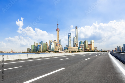 Asphalt highway and modern city commercial buildings in Shanghai,China Poster