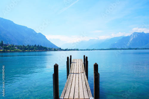 Photo sur Aluminium Lac / Etang Old boat dock near Chateau de Chillon, Montreux, Switzerland at leman geneva lake