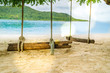 summer holiday, vacation time, the wooden swing on the beach in front of the blue sea