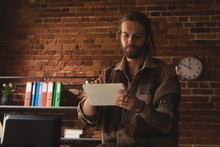 Man Using Digital Tablet Again...