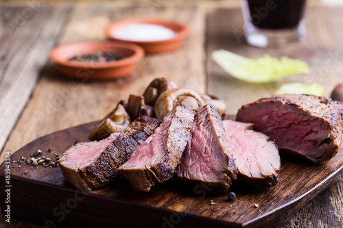 Photo  Roast beef steak with mushrooms
